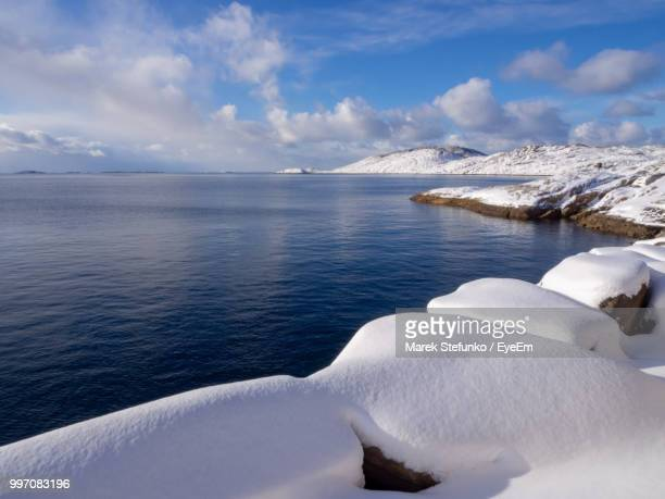 scenic view of sea against sky during winter - marek stefunko stockfoto's en -beelden