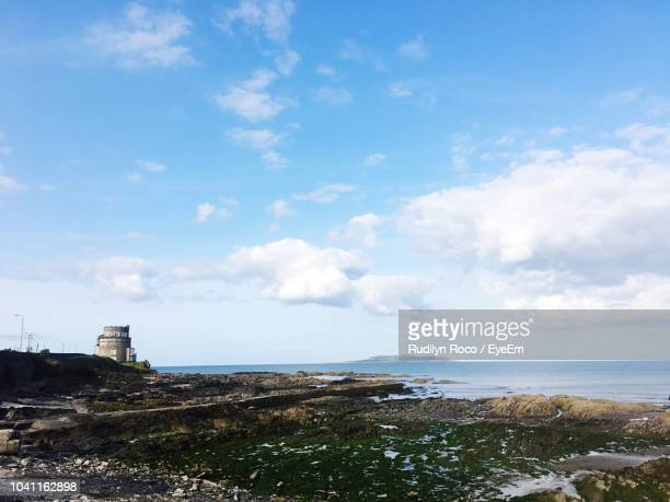 scenic view of sea against sky in city - portmarnock stock photos and pictures