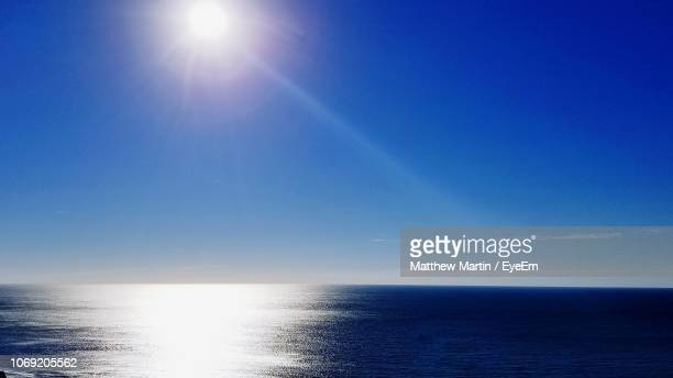scenic view of sea against sky on sunny day - 太陽フレア ストックフォトと画像
