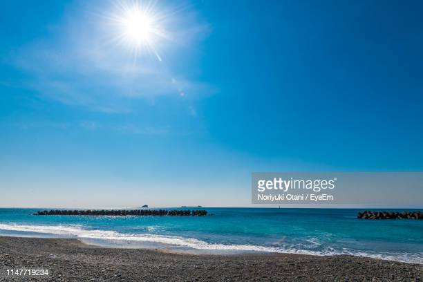 scenic view of sea against sky on sunny day - sun stock pictures, royalty-free photos & images