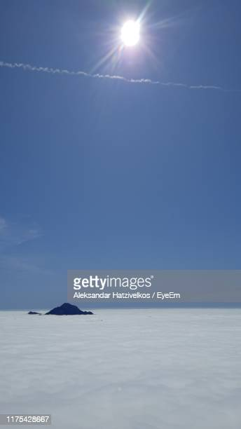 scenic view of sea against sky on sunny day - kranj stock pictures, royalty-free photos & images