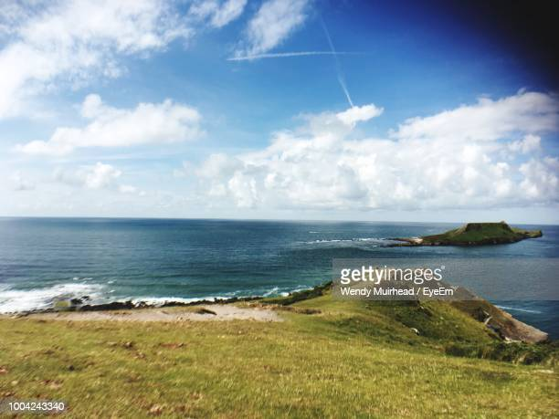 scenic view of sea against sky - llanelli stock pictures, royalty-free photos & images