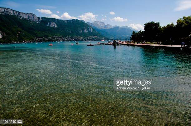 scenic view of sea against sky - annecy photos et images de collection