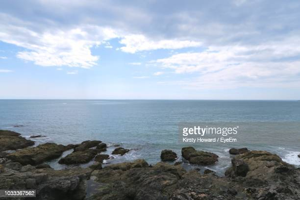 scenic view of sea against sky - low tide stock pictures, royalty-free photos & images