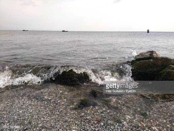 scenic view of sea against sky - hilal stock photos and pictures