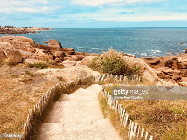 scenic view of sea against sky - perros guirec photos et images de collection
