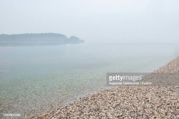 scenic view of sea against sky - cetkauskas stock pictures, royalty-free photos & images