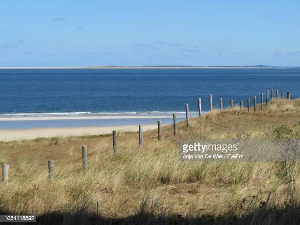 scenic view of sea against sky - noord holland stockfoto's en -beelden