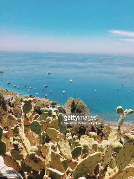 scenic view of sea against sky - taormina stock pictures, royalty-free photos & images