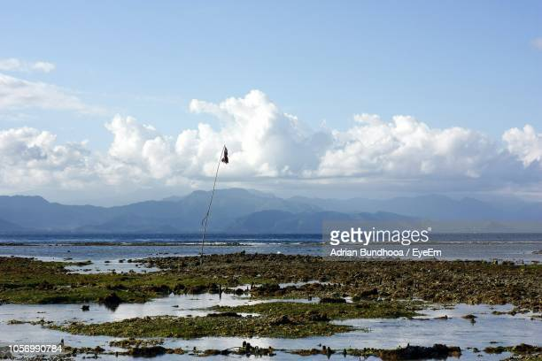 scenic view of sea against sky - denpasar stock pictures, royalty-free photos & images