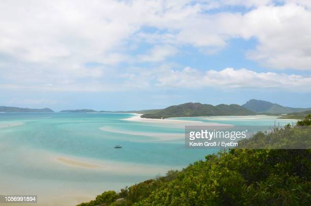 scenic view of sea against sky - whitsunday island stock photos and pictures