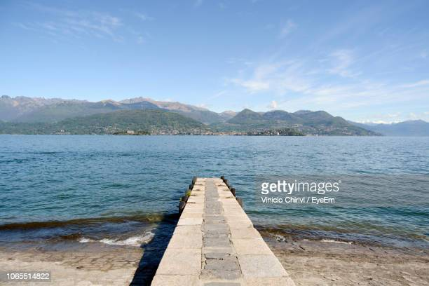 scenic view of sea against sky - stresa stock pictures, royalty-free photos & images