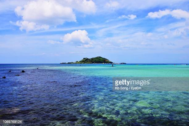 scenic view of sea against sky - jeju stock photos and pictures