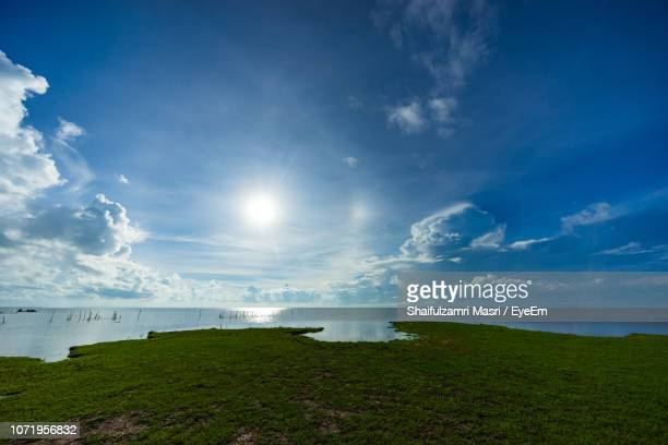 scenic view of sea against sky - shaifulzamri stock pictures, royalty-free photos & images