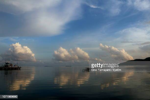 scenic view of sea against sky - dewi fatmayanti stock photos and pictures
