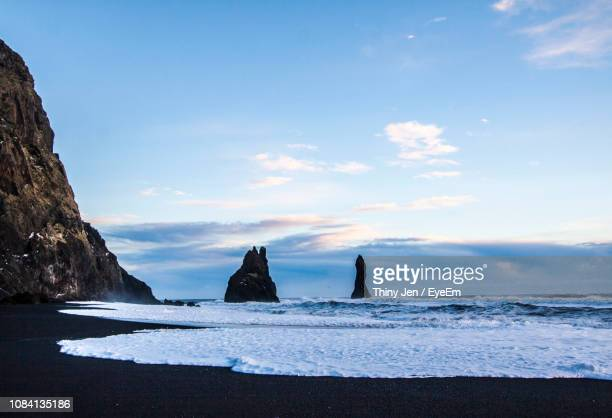 scenic view of sea against sky - punalu'u_beach stock pictures, royalty-free photos & images
