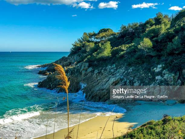 scenic view of sea against sky - ramatuelle stock photos and pictures