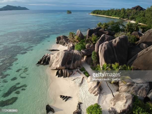 scenic view of sea against sky - la digue island stock pictures, royalty-free photos & images
