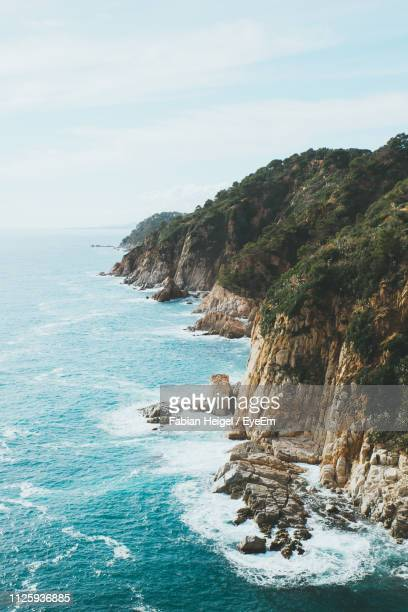scenic view of sea against sky - gerona province stock photos and pictures
