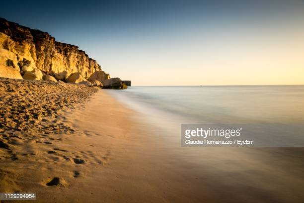 scenic view of sea against sky - claudia romanazzo foto e immagini stock