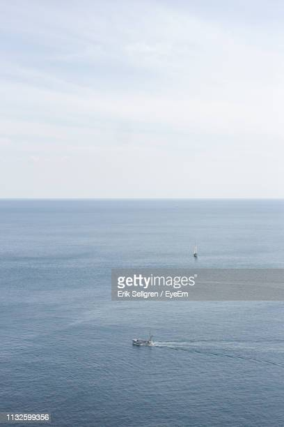 scenic view of sea against sky - waterfront stock pictures, royalty-free photos & images