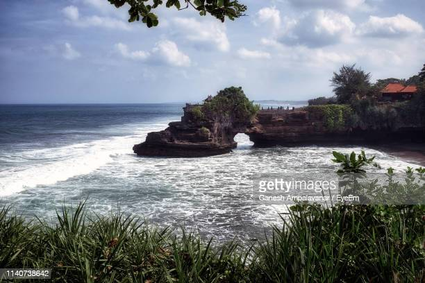 scenic view of sea against sky - tanah lot stock pictures, royalty-free photos & images