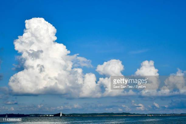 scenic view of sea against sky - cumulonimbus stock pictures, royalty-free photos & images