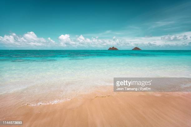 scenic view of sea against sky - kailua stock pictures, royalty-free photos & images