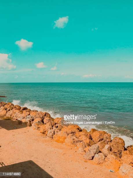 scenic view of sea against sky - lorena cartagena stock photos and pictures