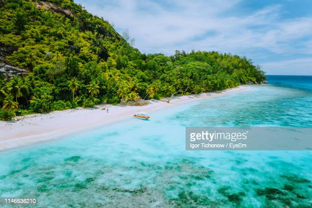 scenic view of sea against sky - seychelles stock pictures, royalty-free photos & images