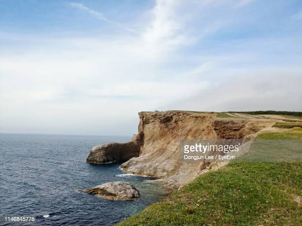 scenic view of sea against sky - eroded stock pictures, royalty-free photos & images