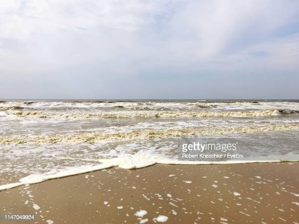 scenic view of sea against sky - north holland stock pictures, royalty-free photos & images