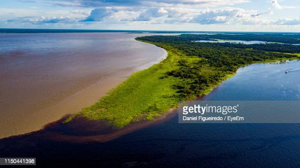 scenic view of sea against sky - manaus stock pictures, royalty-free photos & images