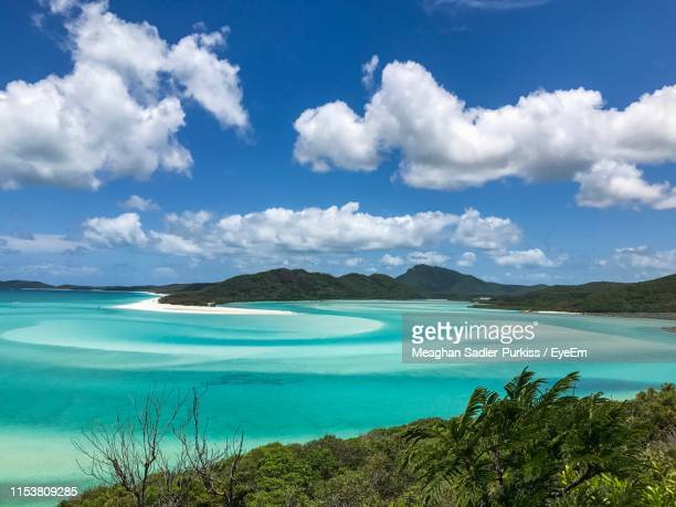 scenic view of sea against sky - whitehaven beach stock-fotos und bilder