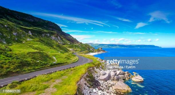 scenic view of sea against sky - county antrim stock pictures, royalty-free photos & images