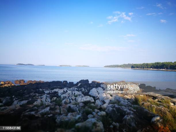 scenic view of sea against sky - thiem stock pictures, royalty-free photos & images