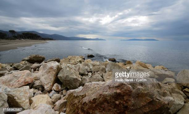 scenic view of sea against sky - pastore maremmano foto e immagini stock
