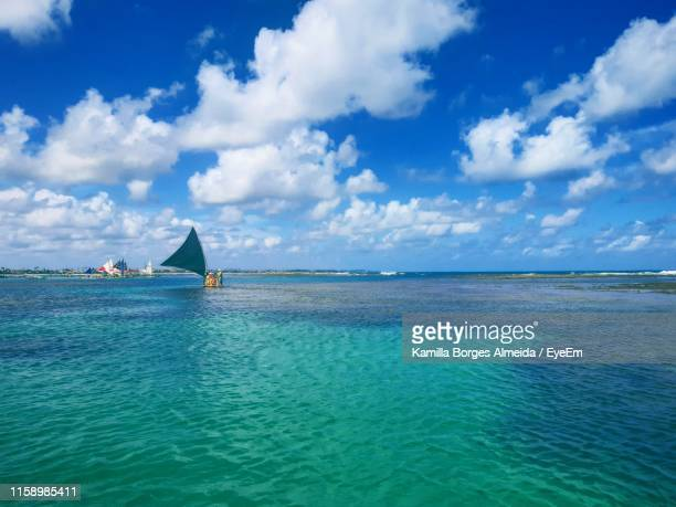 scenic view of sea against sky - porto galinhas stock photos and pictures
