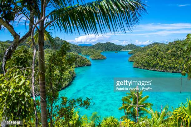 scenic view of sea against sky - island stock pictures, royalty-free photos & images