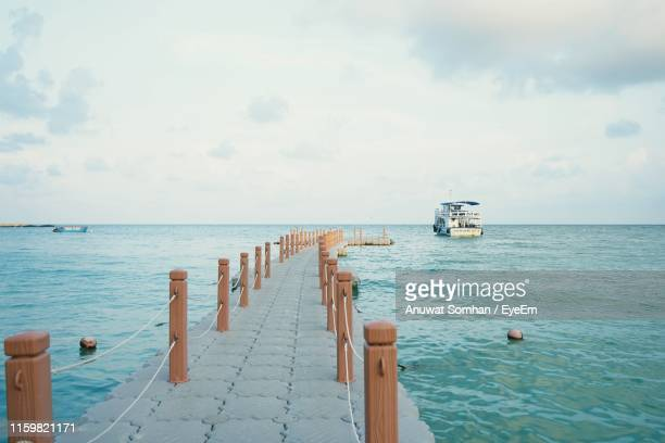 scenic view of sea against sky - anuwat somhan stock photos and pictures