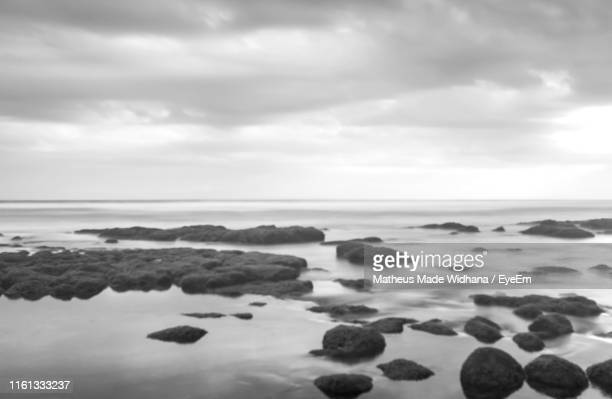 scenic view of sea against sky - made widhana stock photos and pictures