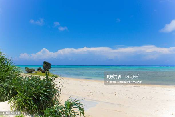 scenic view of sea against sky - okinawa prefecture stock pictures, royalty-free photos & images