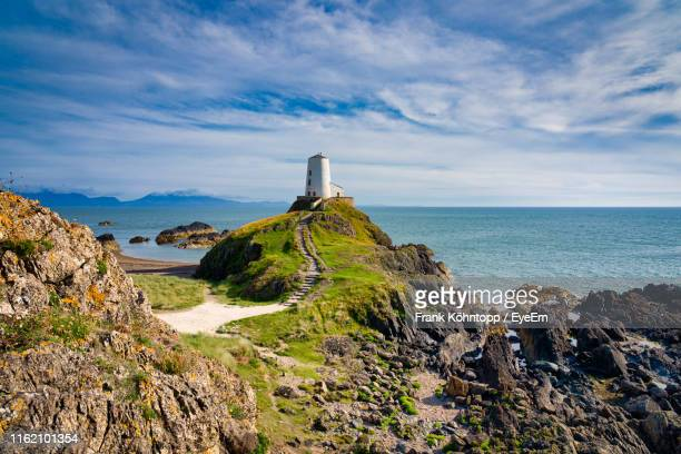 scenic view of sea against sky - snowdonia stock photos and pictures