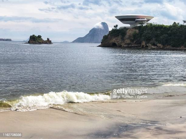 scenic view of sea against sky - niteroi stock pictures, royalty-free photos & images