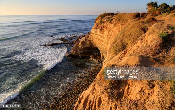 scenic view of sea against sky - rocky coastline stock pictures, royalty-free photos & images