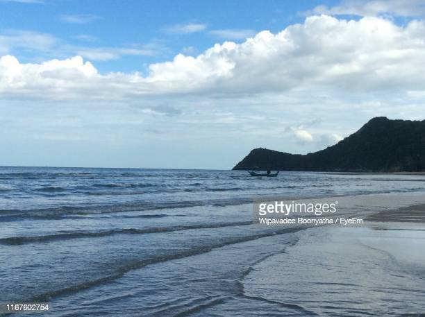 scenic view of sea against sky - wipavadee stock photos and pictures