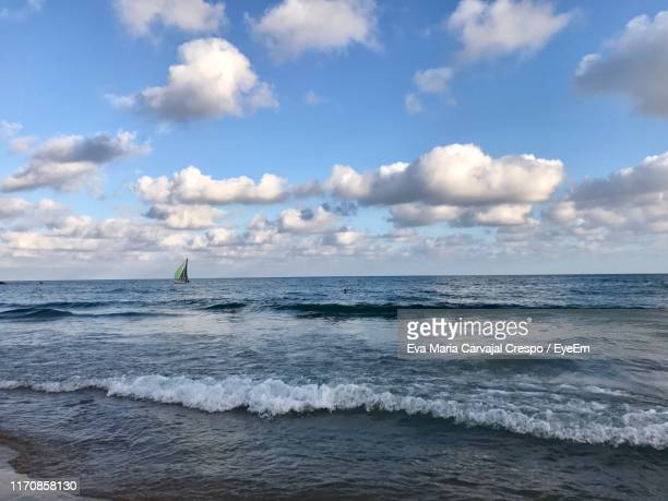 scenic view of sea against sky - carvajal stock photos and pictures