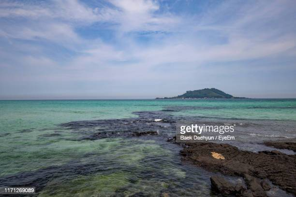 scenic view of sea against sky - jeju island stock pictures, royalty-free photos & images
