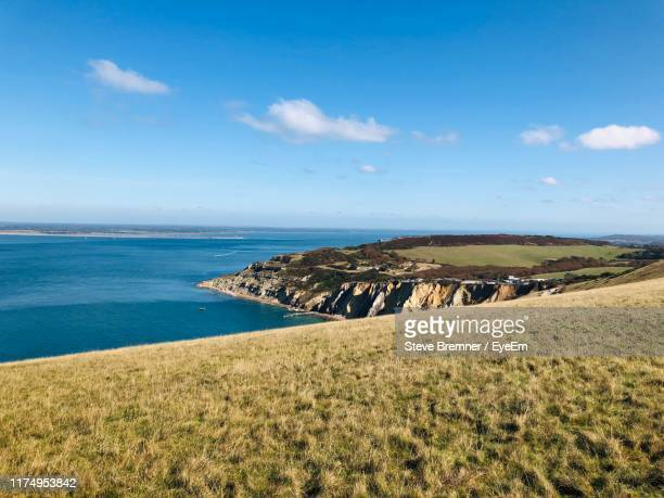 scenic view of sea against sky - totland bay stock pictures, royalty-free photos & images
