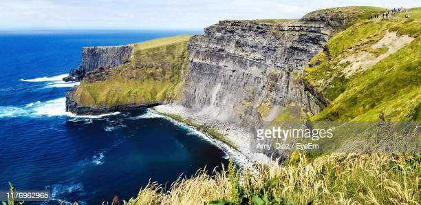 scenic view of sea against sky - rock formation stock pictures, royalty-free photos & images